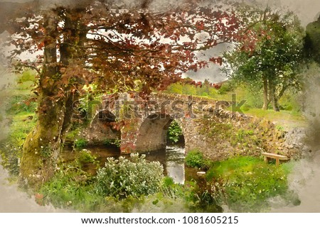 Watercolor painting of Landscape image of old medieval bridge in river setting in English countryside