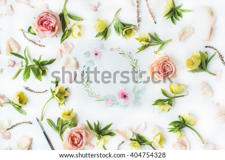 Watercolor painting, roses petals, yellow flowers and green leaves on white background. Flat lay, top view. wreath frame
