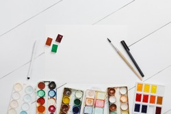 Watercolor painting. Used palette of watercolor paints isolated on white background. art school concept. Colorful Messy Used Paints. Child painter draws a watercolor drawing. Preparing for sketching