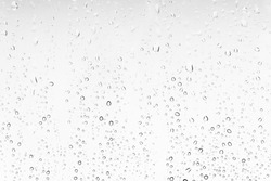 Waterdrops background on a window. White texture of rain