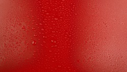 Waterdrops on a red background. Background. Water drops