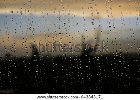 Waterdrops on blurred sunset background. #643843171