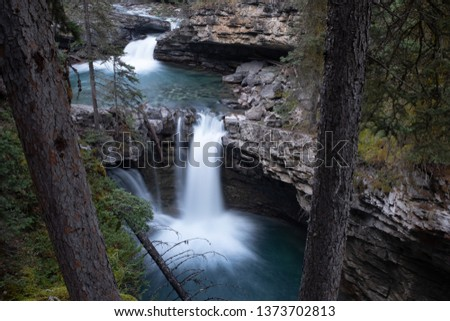 Waterfall along the Johnson Canyon trial in Banff National Park, Canada, taken on a long exposure to smooth out the water and give a milky effect