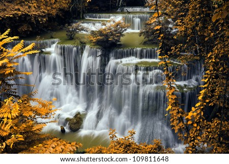 Waterfall and blue stream in the yellow forest spring season in Thailand