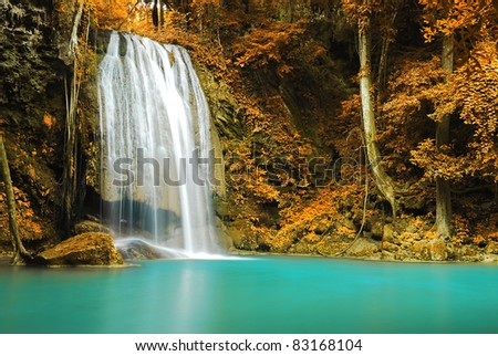 Waterfall and blue stream in the yellow forest Thailand