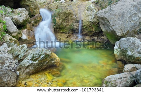 Waterfall and greater stones. Natural composition