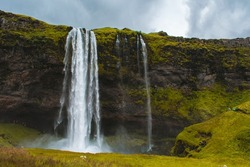 Waterfall and gree grass landscape