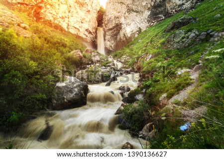Waterfall and streams of water streams lit by the evening sun