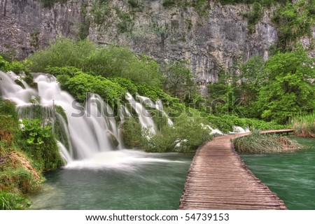 Waterfall and wooden path
