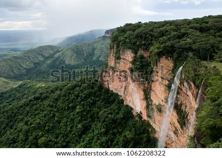 Waterfall at Chapada dos Guimarães,next to the capital of Mato Grosso State. Cerrado plants, a vast tropical savanna eco region of Brazil