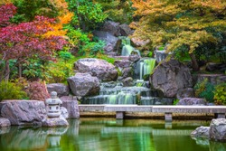Waterfall at Kyoto garden in Holland park in London during autumn