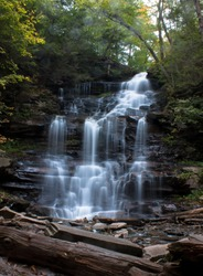 Waterfall at Ricketts Glen State Park, Benton, PA, in crisp autumn weather, Ganoga Falls 94' portrait with prominent rock foreground