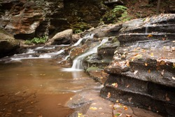 Waterfall at Ricketts Glen State Park, Benton, PA, in crisp autumn weather, gentle cascading falls over rocks