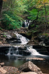 Waterfall at Ricketts Glen State Park, Benton, PA, in crisp autumn weather, portrait zoom of Waters Meet point