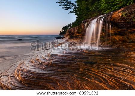 Waterfall at the beach. Taken at Pictured Rocks National Lakeshore, Lake Superior, Michigan, USA