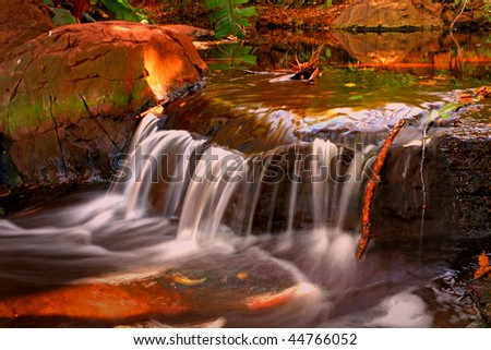 Waterfall base - stock photo