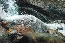 Waterfall beautiful waterfall in the Park Sapokka Finland. The water spray from the waterfall closeup