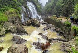 Waterfall cascade in jungle cliffs rock mountain river motion
