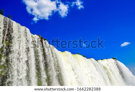 Waterfall close view on blue sky background
