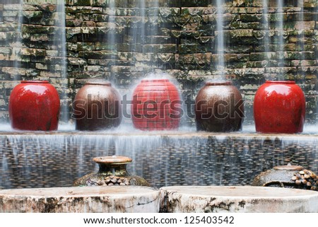 Waterfall decorate with colorful pots.