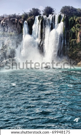 Waterfall, famous place of Antalya, Turkey. Clear sea and blue sky in summer