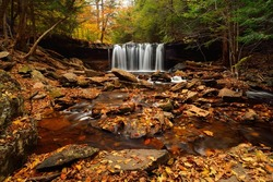 Waterfall in autumn foliage at Rickets Glen State park, Pennsylvania