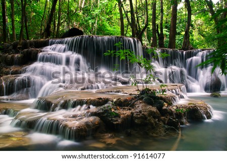 waterfall in deep forest at huay mae ka min of Karnjanaburi in Thailand - stock photo