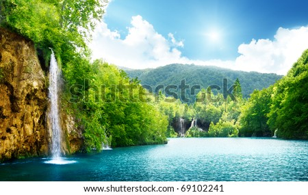 waterfall in deep forest of...