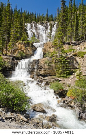 waterfall in deep forest of Rocky Mountains, Alberta, Canada.