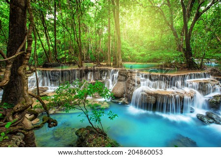 Waterfall in deep forest, Thailand stock photo