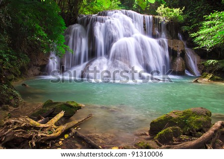 Waterfall in deep perfect green forest