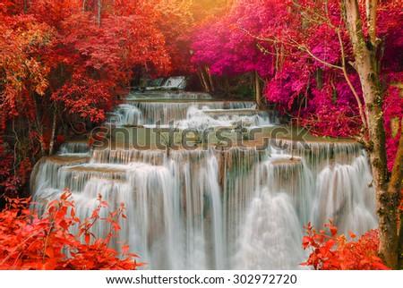 Waterfall in deep rain forest jungle (Huay Mae Kamin Waterfall in Kanchanaburi Province, Thailand) #302972720