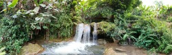 Waterfall in forest at northern Thailand,waterfall panorama view background.