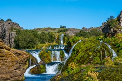 Waterfall in Gjain in thjorsardalur valley in South Iceland on a sunny summer day