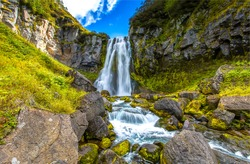 Waterfall in green moss mountain forest
