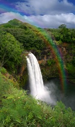 Waterfall in Hawaii With a Colorful Fantastic Rainbow