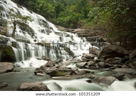 Waterfall in  in thai national park. In the deep forest on mountain
