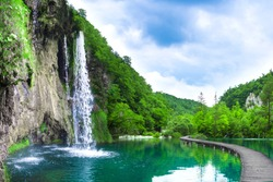 waterfall in mountain lake and green park. Croatia.