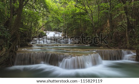 Waterfall in national deep forest of Thailand - stock photo