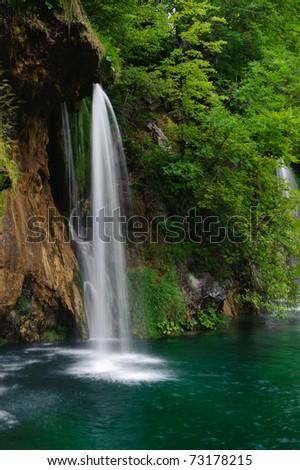 Waterfall in national park. Plitvice, Croatia. Popular touristic destination.