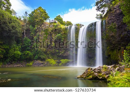 Shutterstock Waterfall in New Zealand forest with trees