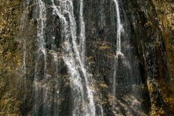 Waterfall in northern Italy, alps: cold and pure water