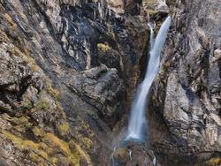 Waterfall in Pineta Valley, Ordesa and Monte Perdido National Park, Autumn scene, Huesca province, Spain