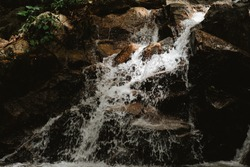 Waterfall in Thailand,stream of water from the waterfall.