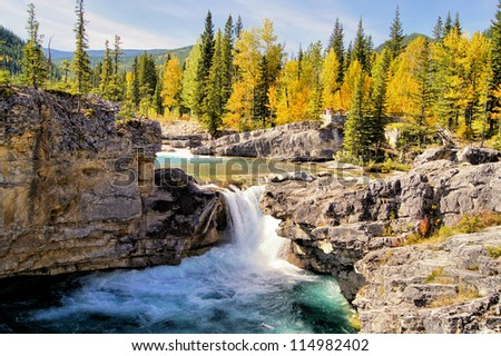 Waterfall in the Kananaskis region of the Canadian Rockies during autumn #114982402