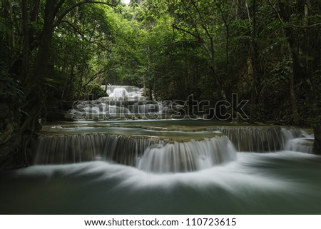 waterfall in tropical deep forest