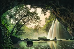 Waterfall in tropical forest at Khao Yai National Park, Thailand. Waterfall view from inside the cave.