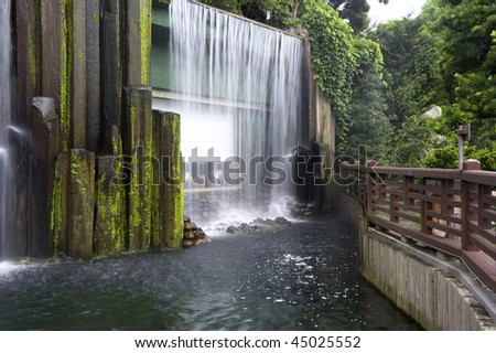 stock-photo-waterfall-inside-the-chinese-garden-in-chi-lin-nunnery-hong-kong-45025552.jpg
