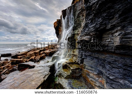 Waterfall landscape and seascape on the southern British coast