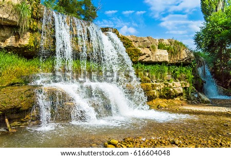 Waterfall landscape. Waterfall close up. Waterfall in nature